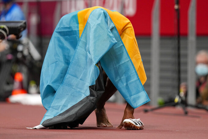 Steven Gardiner, of the Bahamas, reacts after winning the men's 400-meter final at the 2020 Summer Olympics, Thursday, Aug. 5, 2021, in Tokyo. (AP Photo/Petr David Josek)
