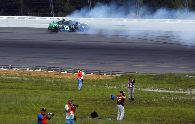 Brandon Jones crashes in Turn One during the NASCAR Xfinity Series auto race at Pocono Raceway, Saturday, June 1, 2019, in Long Pond, Pa. (AP Photo/Matt Slocum)