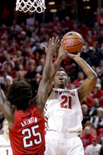 Wisconsin's Khalil Iverson (21) goes to the basket against Nebraska's Nana Akenten (25) during the first half of an NCAA college basketball game in Lincoln, Neb., Tuesday, Jan. 29, 2019. (AP Photo/Nati Harnik)