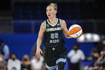 Chicago Sky guard Courtney Vandersloot (22) brings the ball up court against the Dallas Wings during the first half in the first round of the WNBA basketball playoffs, Thursday, Sept. 23, 2021, in Chicago. (AP Photo/Kamil Krzaczynski)