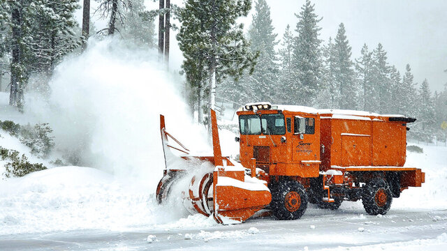 In this photo provided by Snow Valley Mountain Resort a snowplow clearing a road near the ski area at Running Springs in the San Gabriel Mountains of Southern California Monday, Dec. 28, 2020. Rain, hail, and snow fell Monday as Southern California saw its first significant storm of the season. Lightning flashed and thunder sounded as the storm front swept across the region in the middle of the night, unleashing downpours followed by bands of rain that were expected to continue through the afternoon. (Snow Valley Mountain Resort via AP)