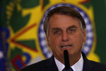 Brazil's President Jair Bolsonaro speaks during a ceremony to present the government's agenda to the newly elected mayors, at the Planalto Presidential Palace, in Brasilia, Brazil, Feb. 23, 2021. (AP Photo/Eraldo Peres)