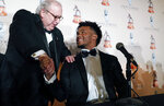 Heisman Trophy winner quarterback Kyler Murray, right, shakes hands with David O'Brien Jr. after the Davey O'Brien football award at a news conference in Fort Worth, Texas, Monday, Feb. 18, 2019. Murray accepted the Davey O'Brien award in his first public appearance since he announced his plan to pursue an NFL career rather than report to spring training as a first-round pick of the Oakland A's. (AP Photo/LM Otero)