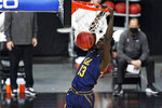 California's Kuany Kuany (13) dunks against Stanford during the first half of an NCAA college basketball game in the first round of the Pac-12 men's tournament Wednesday, March 10, 2021, in Las Vegas. (AP Photo/John Locher)