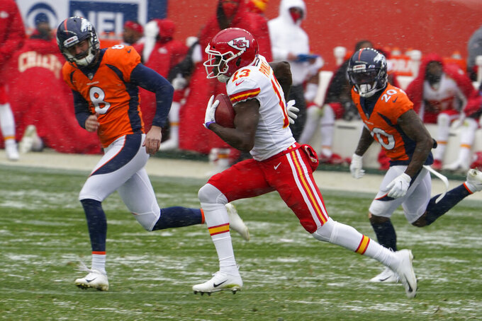 Kansas City Chiefs kick returner Byron Pringle runs a kickoff back for a touchdown as Denver Broncos kicker Brandon McManus, left, and cornerback Duke Dawson, right, can't catch him during the first half of an NFL football game Sunday, Oct. 25, 2020, in Denver. (AP Photo/Jack Dempsey)