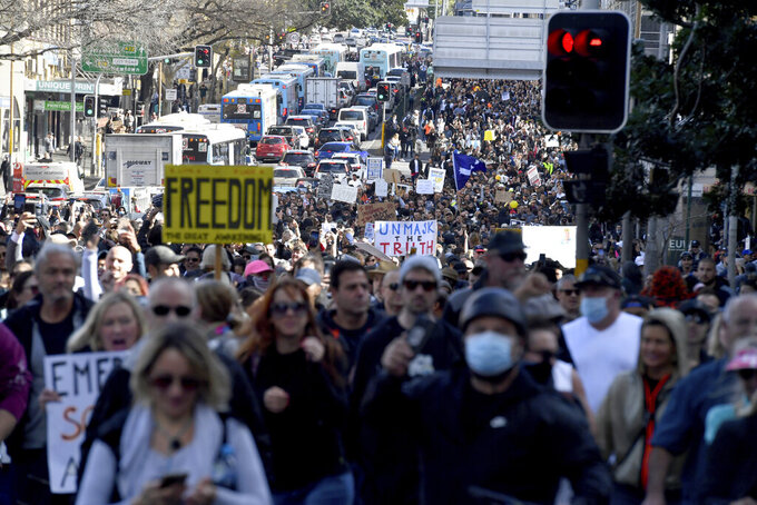 Protesters march through the streets during a 'World Wide Rally For Freedom' anti-lockdown rally in Sydney, Saturday, July 24, 2021. (Mick Tsikas/AAP Image via AP)
