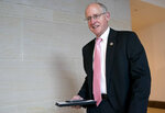 In this March 8, 2018, photo, Rep. Mike Conaway, R-Texas, left, at the Capitol in Washington. Republicans on the House intelligence committee have completed a draft report concluding there was no collusion or coordination between Donald Trump's presidential campaign and Russia. The finding is sure to please the White House and enrage panel Democrats who have not yet seen the document. After a yearlong investigation, Conaway says the committee has finished doing witness interviews. (AP Photo/Andrew Harnik)