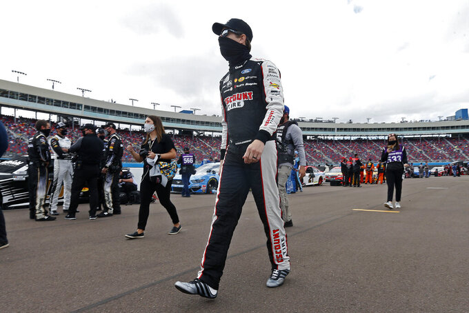 Brad Keselowski walks down pit road prior to the NASCAR Cup Series auto race at Phoenix Raceway, Sunday, Nov. 8, 2020, in Avondale, Ariz. (AP Photo/Ralph Freso)