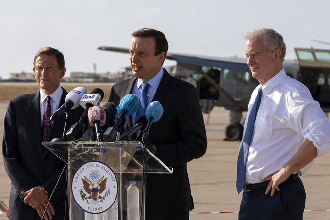 Sen. Chris Murphy, D-C.T., center, Sen. Chris Van Hollen, D-Md., right, and Sen. Richard Blumenthal, D-C.T., attend a press conference at the military airbase in Beirut airport, Lebanon, Wednesday, Sept. 1, 2021. A delegation of four U.S. senators visiting Lebanon promised to work on easing Lebanon's crippling economic crisis. (AP Photo/ Hassan Ammar)