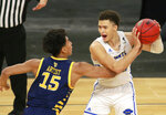 UC Santa Barbara's Jaquori McLaughlin (3) keeps the ball from the reach of UC Irvine's Jeron Artest (15) during the second half of an NCAA college basketball game for the championship of the Big West Conference men's tournament Saturday, March 13, 2021, in Las Vegas. UC Santa Barbara won 79 to 63. (AP Photo/Ronda Churchill)