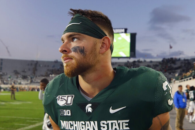 FILE - In this Sept. 28, 2019, file photo, Michigan State linebacker Joe Bachie walks off the field following an NCAA college football game against Indiana in East Lansing, Mich. Bachie has been declared ineligible by the Big Ten after testing positive for a banned supplement. The school says it will appeal. (AP Photo/Al Goldis, File)