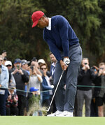 USA captain Tiger Woods hits an approach shot during a practice session ahead of the President's Cup Golf tournament in Melbourne, Tuesday, Dec. 10, 2019. (AP Photo/Andy Brownbill)