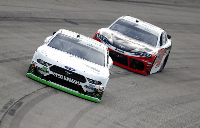 Cole Custer, left, leads Christopher Bell during a NASCAR Xfinity Series auto race, Sunday, June 16, 2019, at Iowa Speedway in Newton, Iowa. (AP Photo/Charlie Neibergall)