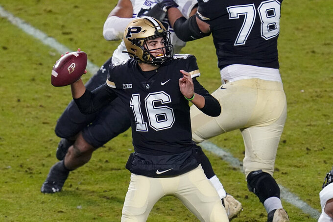 Purdue quarterback Aidan O'Connell (16) throws against Northwestern during the first half of an NCAA college football game in West Lafayette, Ind., Saturday, Nov. 14, 2020. (AP Photo/Michael Conroy)