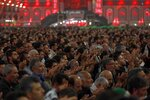 Shiite Muslim worshippers pray inside the holy shrine of Imam Abbas ahead of the Arbaeen festival in Karbala, Iraq, Friday, Oct. 18, 2019. The holiday marks the end of the forty day mourning period after the anniversary of the martyrdom of Imam Hussein, the Prophet Muhammad's grandson in the 7th century. (AP Photo/Hadi Mizban)