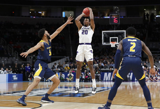 Kansas State forward Xavier Sneed (20) shoots between UC Irvine forward Jonathan Galloway (5) and guard Max Hazzard (2) during the first half of a first round men's college basketball game in the NCAA Tournament Friday, March 22, 2019, in San Jose, Calif. (AP Photo/Chris Carlson)