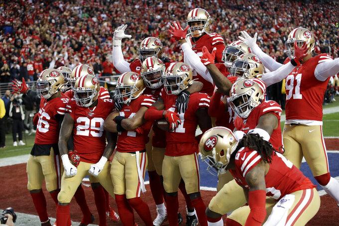 The San Francisco 49ers celebrates after interception by defensive back Emmanuel Moseley (41) during the first half of the NFL NFC Championship football game against the Green Bay Packers Sunday, Jan. 19, 2020, in Santa Clara, Calif. (AP Photo/Marcio Jose Sanchez)