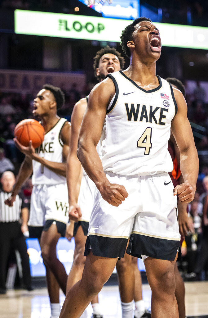 Wake Forest freshman guard Jahcobi Neath (4) celebrates after scoring a basket and drawing a foul during an NCAA college basketball game against Virginia Tech Tuesday, Jan. 14, 2020 in Winston-Salem, N.C. (Andrew Dye/Winston-Salem Journal via AP)