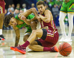 Notre Dame's Prentiss Hubb (3) and Boston College's Derryck Thornton (11) fight for a loose ball during an NCAA college basketball game Saturday, Dec. 7, 2019 at Purcell Pavilion in South Bend, Ind. (Michael Caterina/South Bend Tribune via AP)