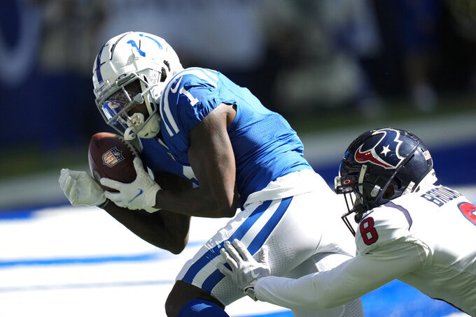 Indianapolis Colts' Parris Campbell (1) makes a touchdown catch against Houston Texans' Terrence Brooks (8) during the first half of an NFL football game, Sunday, Oct. 17, 2021, in Indianapolis. (AP Photo/AJ Mast)