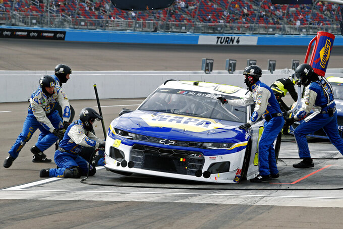 Chase Elliott (9) makes a pit stop for tires and fuel during the NASCAR Cup Series auto race at Phoenix Raceway, Sunday, Nov. 8, 2020, in Avondale, Ariz. (AP Photo/Ralph Freso)