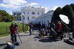 Members of the media gather outside the White House, Friday, Oct. 2, 2020, in Washington. (AP Photo/Alex Brandon)