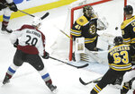 Colorado Avalanche's Nathan MacKinnon (29), left, shoots the puck into the net past Boston Bruins' Jaroslav Halak, of Slovakia (41) to score as Bruins' Brad Marchand (63) and Zdeno Chara, of Slovakia, top right, look on during the first period of an NHL hockey game, Sunday, Feb. 10, 2019, in Boston. (AP Photo/Steven Senne)
