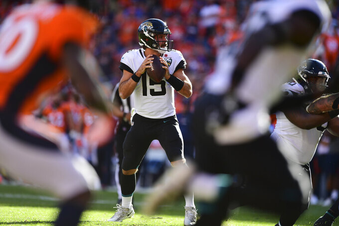 Jacksonville Jaguars quarterback Gardner Minshew II (15) looks for an open receiver during the second half in the NFL game against the Denver Broncos in Denver Sunday, Sept. 29, 2019.(Eric Bakke via AP)