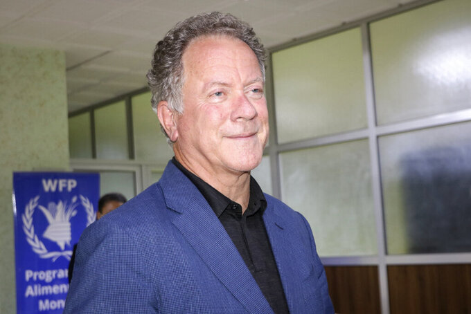 """FILE - World Food Program (WFP) Executive Director David Beasley speaks to the media about the organization's Nobel Peace Prize win, at the airport in Ouagadougou, Burkina Faso, late Friday, Oct. 9, 2020.  Beasley says the Nobel Peace Prize has given the U.N. agency a spotlight and megaphone to warn world leaders that next year is going to be worse than this year, and without billions of dollars """"we are going to have famines of biblical proportions in 2021.""""   (AP Photo/Sam Mednick)"""