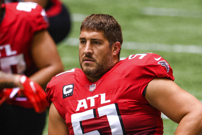 Atlanta Falcons center Alex Mack (51) stretches before an NFL football game against the Detroit Lions, Sunday, Oct. 25, 2020, in Atlanta. Mack is one of 32 players nominated for the seventh annual Art Rooney Sportsmanship Award, the NFL announced Thursday, Dec. 3, 2020. (AP Photo/Danny Karnik)