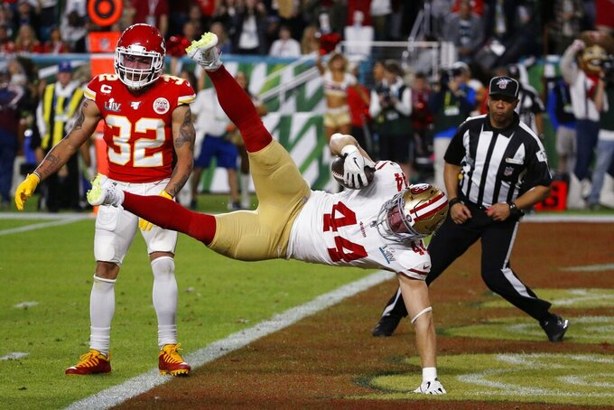 San Francisco 49ers' Kyle Juszczyk (44) falls into the end zone for a touchdown the Kansas City Chiefs during the first half of the NFL Super Bowl 54 football game Sunday, Feb. 2, 2020, in Miami Gardens, Fla. (AP Photo/Mark Humphrey)