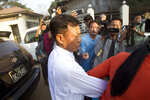 Moe Yan Naing, front left, walks outside Insein prison after his release in Yangon, Myanmar Friday, Feb. 1, 2019. The former police officer was sentenced to a year in jail for violating the Police Disciplinary Act after he testified during the trial of two Reuters journalists that he was ordered to help entrap the two who were accused of possessing state secrets. (AP Photo/Thein Zaw)