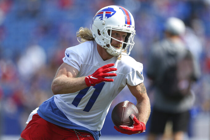 FILE - In this July 31, 2021, file photo, Buffalo Bills wide receiver Cole Beasley (11) runs after a catch during NFL football practice in Orchard Park, N.Y. Now, in the grips of another seminal national tragedy, one that has produced a 9/11-like death toll many days over for the last year and a half, we're much more realistic about the role that sports can play in the recovery process. While most professional and college athletes have gotten vaccinated against COVID-19 — seizing on our best hope to end this scourge — there have been plenty of vocal holdouts who consider it an infringement on their freedom. (AP Photo/Joshua Bessex, File)