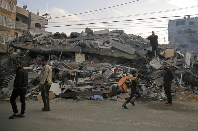 A residential building was destroyed by Israeli airstrikes, in Gaza City, Tuesday, Nov. 13, 2018. (AP Photo/Hatem Moussa)