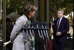 Attorney Gloria Allred, left, who represents several of Harvey Weinstein's accusers, makes way for Weinstein's attorney Mark Werksman at a news conference following an arraignment for the convicted rapist and former movie mogul on additional sexual assault charges in California, at the Clara Shortridge Foltz Criminal Justice Center, Wednesday, July 21, 2021, in Los Angeles. (AP Photo/Chris Pizzello)