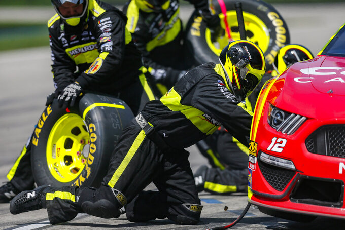 Ryan Blaney's pit crew service his car during a NASCAR Cup auto race at Texas Motor Speedway, Sunday, March 31, 2019, in Fort Worth, Texas. (AP Photo/Brandon Wade)