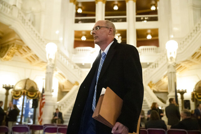 FILE – In this Nov. 20, 2019 file photo, former state prosecutor Frank Fina walks in the Pennsylvania Capitol after oral arguments before the Pennsylvania Supreme Court, in Harrisburg, Pa. Justices issued a 5-1 decision Wednesday, Feb. 19, 2020, to suspend Fina's law license for a year and a day, agreeing with the Office of Disciplinary Counsel that Fina's actions were improper in obtaining grand jury testimony about three top university officials by then-Penn State General Counsel Cynthia Baldwin. (AP Photo/Matt Rourke, File)