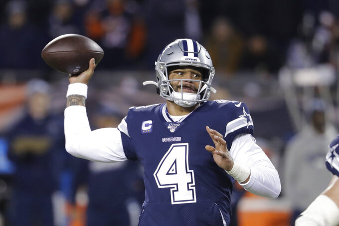 Dallas Cowboys quarterback Dak Prescott (4) throws during the first half of an NFL football game against the Chicago Bears, Thursday, Dec. 5, 2019, in Chicago. (AP Photo/Darron Cummings)