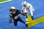 Los Angeles Chargers wide receiver Mike Williams, left, cannot make an end zone catch as Las Vegas Raiders cornerback Isaiah Johnson defends during the second half of an NFL football game Sunday, Nov. 8, 2020, in Inglewood, Calif. (AP Photo/Ashley Landis)