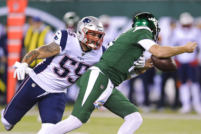 New York Jets quarterback Sam Darnold, right, loses control of the ball as he is sacked by New England Patriots' John Simon (55) during the first half of an NFL football game Monday, Oct. 21, 2019, in East Rutherford, N.J. (AP Photo/Bill Kostroun)