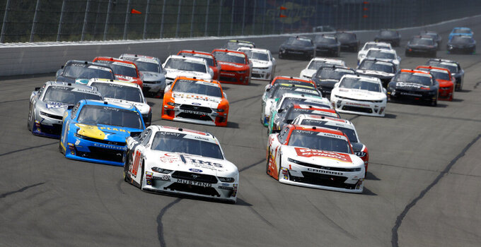 Cole Custer leads the field into Turn One during the NASCAR Xfinity Series auto race at Pocono Raceway, Saturday, June 1, 2019, in Long Pond, Pa. (AP Photo/Matt Slocum)
