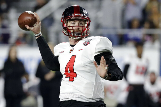 Western Kentucky quarterback Drew Eckels passes against Middle Tennessee in the first half of an NCAA college football game Friday, Nov. 2, 2018, in Murfreesboro, Tenn. (AP Photo/Mark Humphrey)