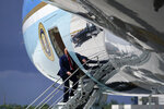 President Donald Trump pauses as he boards Air Force One at Miami International Airport on Friday, July 10, 2020. (AP Photo/Evan Vucci)