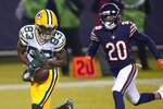 Green Bay Packers' Marquez Valdes-Scantling drops a pass in front of Chicago Bears' Duke Shelley during the second half of an NFL football game Sunday, Jan. 3, 2021, in Chicago. (AP Photo/Charles Rex Arbogast)