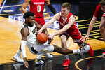 Purdue forward Trevion Williams (50) and Wisconsin forward Tyler Wahl (5) go to the floor for a loose ball during the first half of an NCAA college basketball game in West Lafayette, Ind., Tuesday, March 2, 2021. (AP Photo/Michael Conroy)