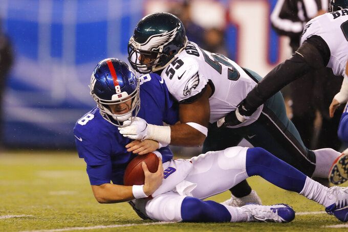 New York Giants quarterback Daniel Jones (8) is sacked by Philadelphia Eagles defensive end Brandon Graham (55) in the first half of an NFL football game, Sunday, Dec. 29, 2019, in East Rutherford, N.J. (AP Photo/Adam Hunger)