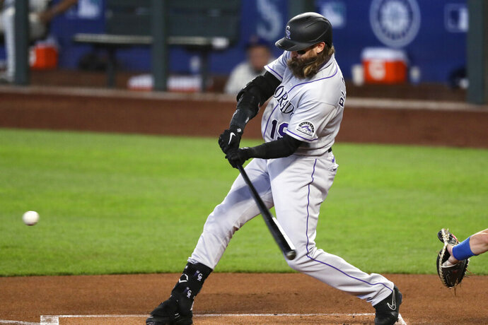 Colorado Rockies' Charlie Blackmon doubles against the Seattle Mariners in the first inning of a baseball game Sunday, Aug. 9, 2020, in Seattle. (AP Photo/Elaine Thompson)