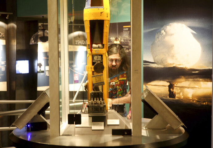 In this Monday, June 10, 2019 photo, a visitor tours the National Atomic Testing Museum in Las Vegas.  Officials at the museum say they have outgrown their space east of the Las Vegas Strip and is looking for a new location to expand its nuclear testing exhibits. (K.M. Cannon/Las Vegas Review-Journal via AP)