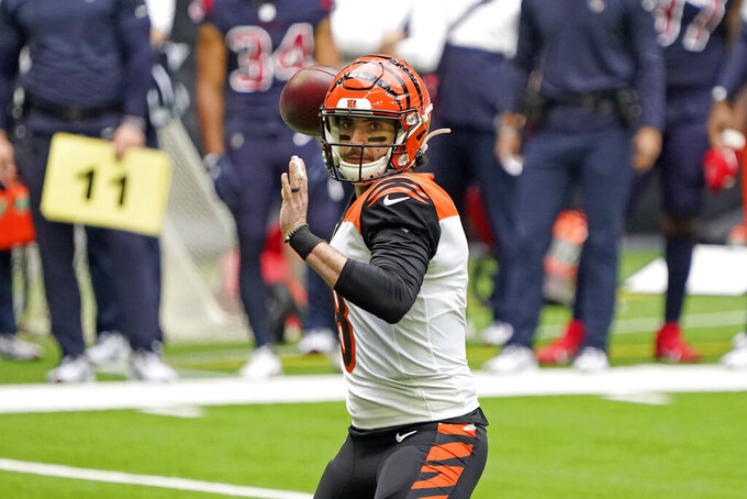 Cincinnati Bengals quarterback Brandon Allen (8) throws a pass for a touchdown to tight end Drew Sample during the first half of an NFL football game against the Houston Texans Sunday, Dec. 27, 2020, in Houston. (AP Photo/Sam Craft)