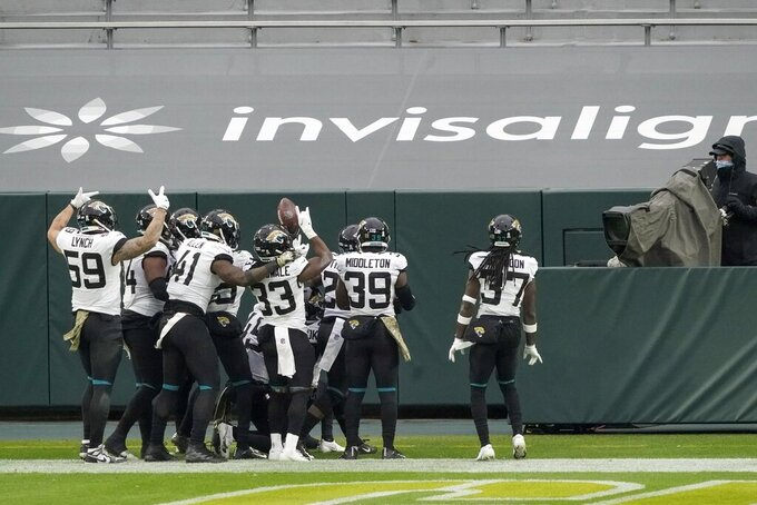 The Jacksonville Jaguars defense celebrates after Sidney Jones intercepted a pass during the second half of an NFL football game against the Green Bay Packers Sunday, Nov. 15, 2020, in Green Bay, Wis. (AP Photo/Morry Gash)
